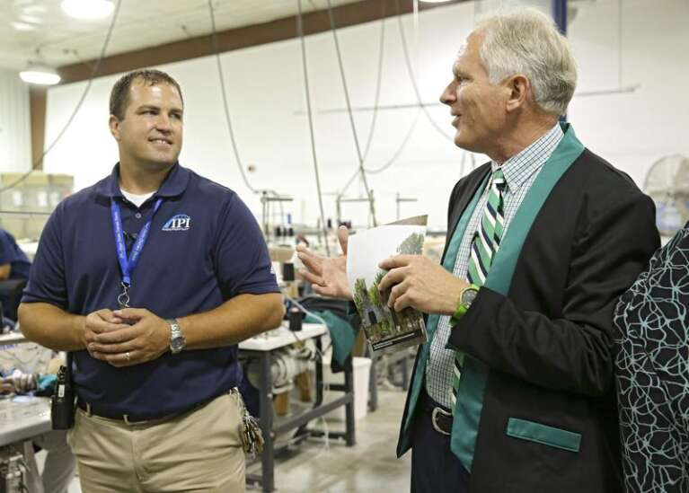 Iowa inmates sewing usher uniforms for new Hancher Auditorium