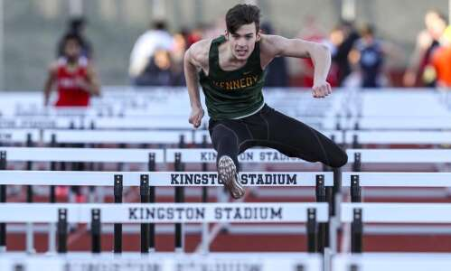 Cedar Rapids Kennedy Cougars vault to the top of the…