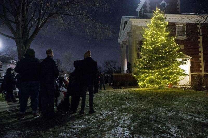Blue spruce damaged in derecho lights up Christmas for Cedar Rapids church