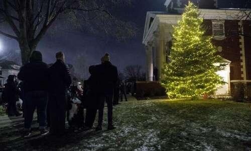 Blue spruce damaged in derecho lights up Christmas for Cedar…