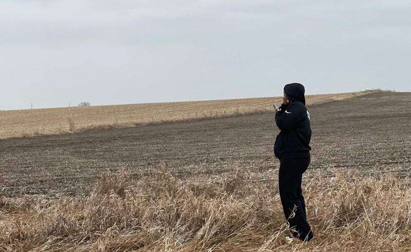 Breasia Terrell's mother waits after unidentified human remains were found near DeWitt