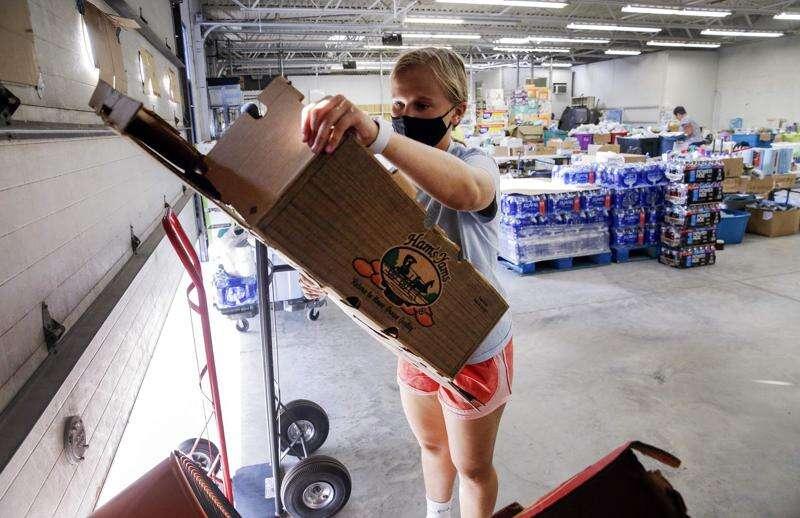 Volunteers like Anna Tuuri, 15, have kept Derecho Resource Center going