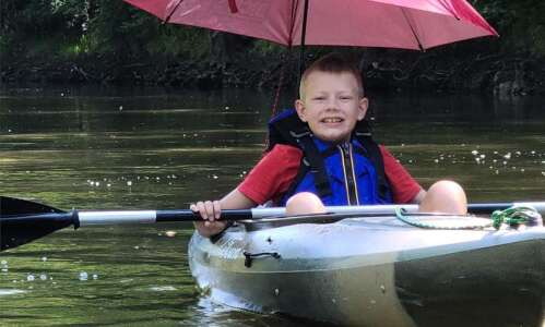 9-year-old and his dad kayak entire Cedar River to raise…
