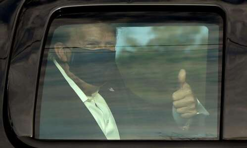 Trump, riding in motorcade, greets supporters