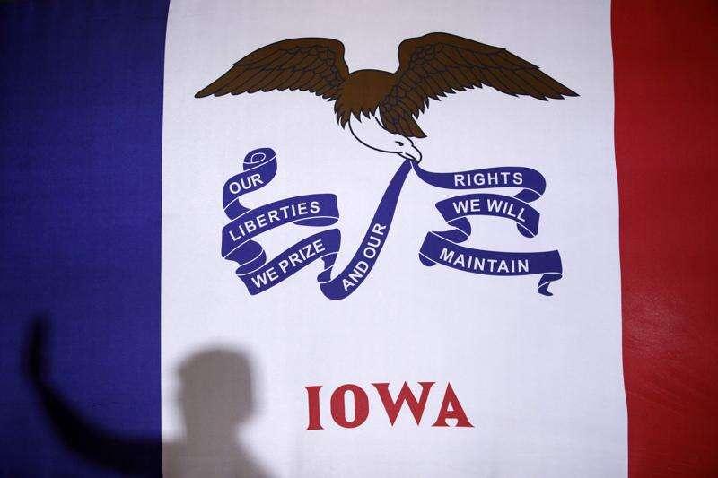 Senators hoping to clinch Iowa caucuses face impeachment wild card