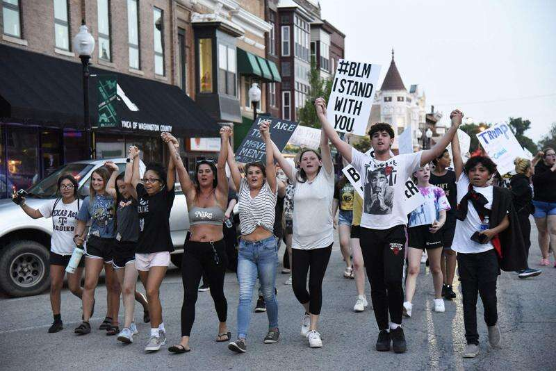 Protesters march downtown to bring awareness, change