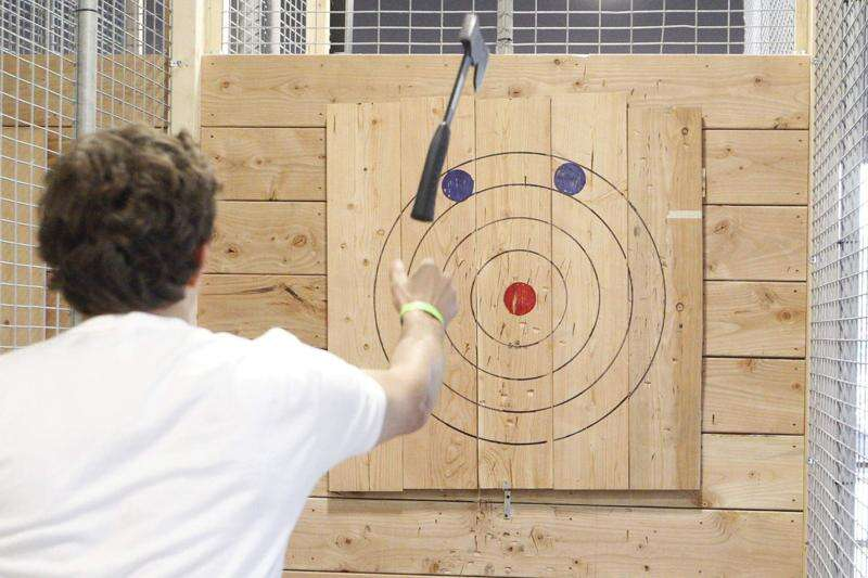 Blowing off steam: Ax throwing bar opens in Iowa City with safety stressed