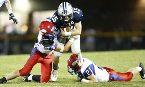No. 1 Cedar Rapids Xavier football overcomes penalty calls in…