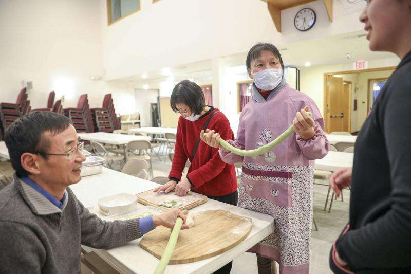Dumplings and fellowship mark New Year for Chinese Church of Iowa City