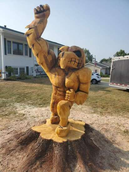 People turn tree debris and stumps from derecho into art