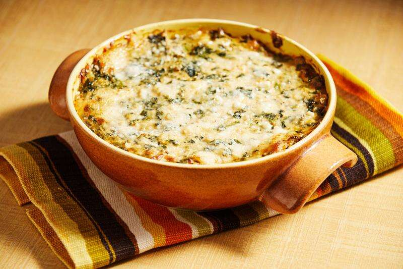 Kick off your holiday party with this bubbling-hot crab and spinach dip