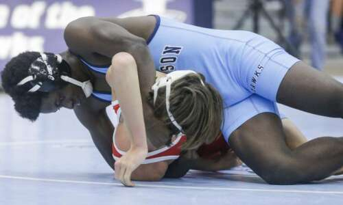 Convinced to try wrestling, Frank Budederi earns first varsity victory…