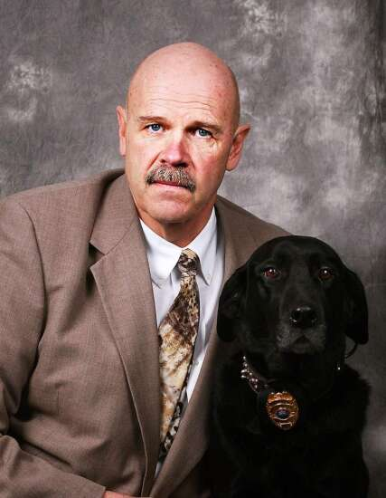 Retired CRFD fire investigator and arson dog handler says goodbye to K-9 partner