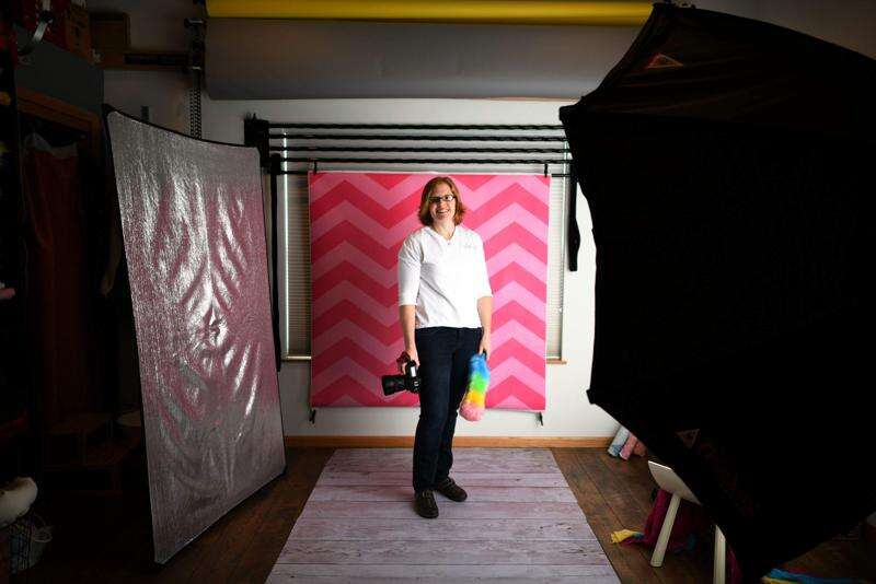 My Biz: Swisher photographer captures the birth experience
