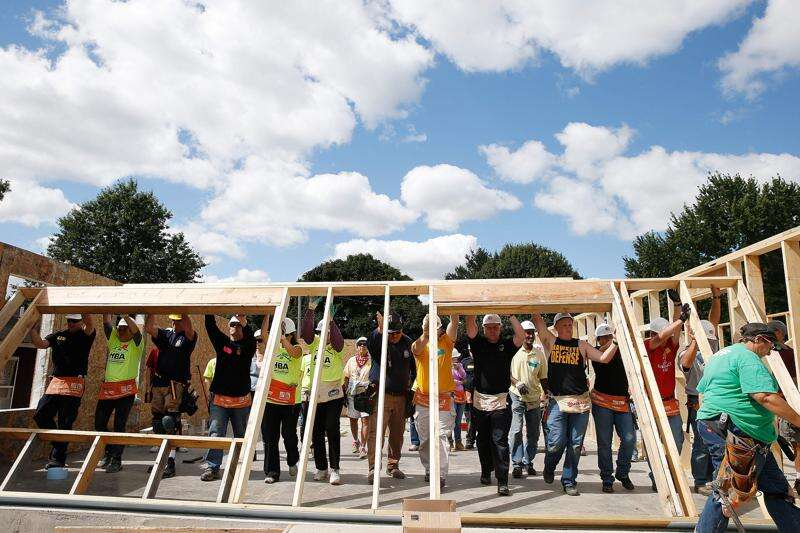 Volunteers help put up house as part of September 11 Day of Service in Iowa City