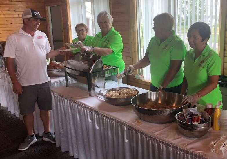 Volunteers help Greater C.R. Open reach tee