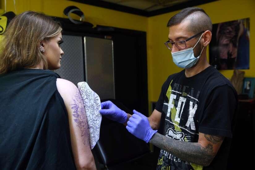 Tattoo shops in Cedar Rapids, Iowa City in high demand, filling up schedules for months