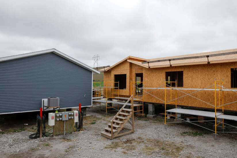 In learning construction skills, prisoners building houses for Iowans
