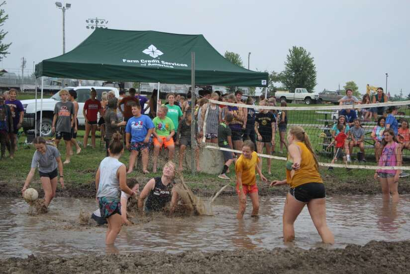 Livestock exhibitors cool off with mud volleyball