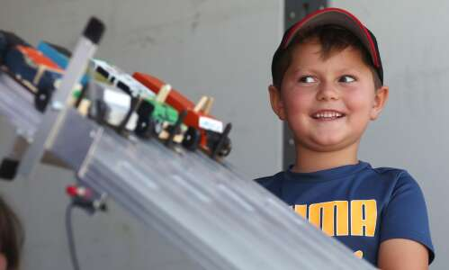 Campers race pinewood trucks at Camp Tanager